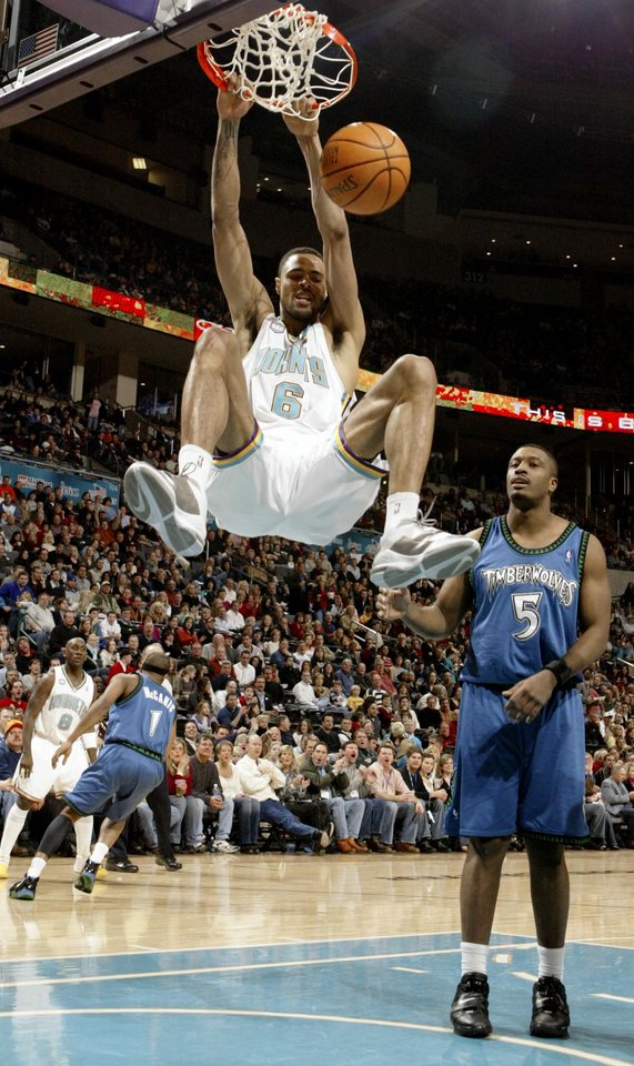 Photo - Hornet Tyson Chandler dunks the ball in front of Craig Smith of the Timberwolves during the New Orleans/Oklahoma City Hornets NBA basketball game against the Minnesota Timberwolves at the Ford Center in Oklahoma City on Friday, Feb., 2, 2007.  By Bryan Terry, The Oklahoman  ORG XMIT: KOD