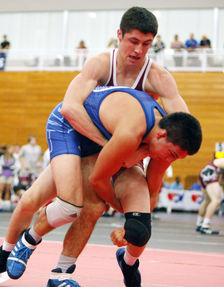 Arizona's Trevor Wilson tries to get control of Oklahoma's Brian Crutchmer during the 132 lb. class of the Junior National Wrestling Duals at Oklahoma City University in Oklahoma City, OK, Friday, June 29, 2012,  By Paul Hellstern, The Oklahoman