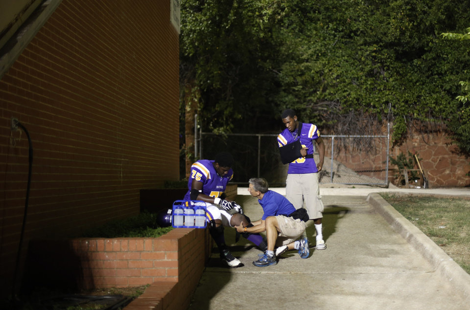 A player is tended to as they come back from halftime at the Northwest Classen vs. Western Heights high school football game at Taft Stadium Thursday, September 20, 2012. Photo by Doug Hoke, The Oklahoman