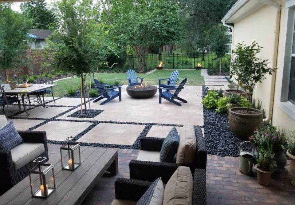Photo -  After: The new yard has three inviting rooms outdoors, a living room, a dining area and a hearth room with chairs circling a fire, greatly expanding the home's usable space. [PHOTO PROVIDED BY TONY EVANS]