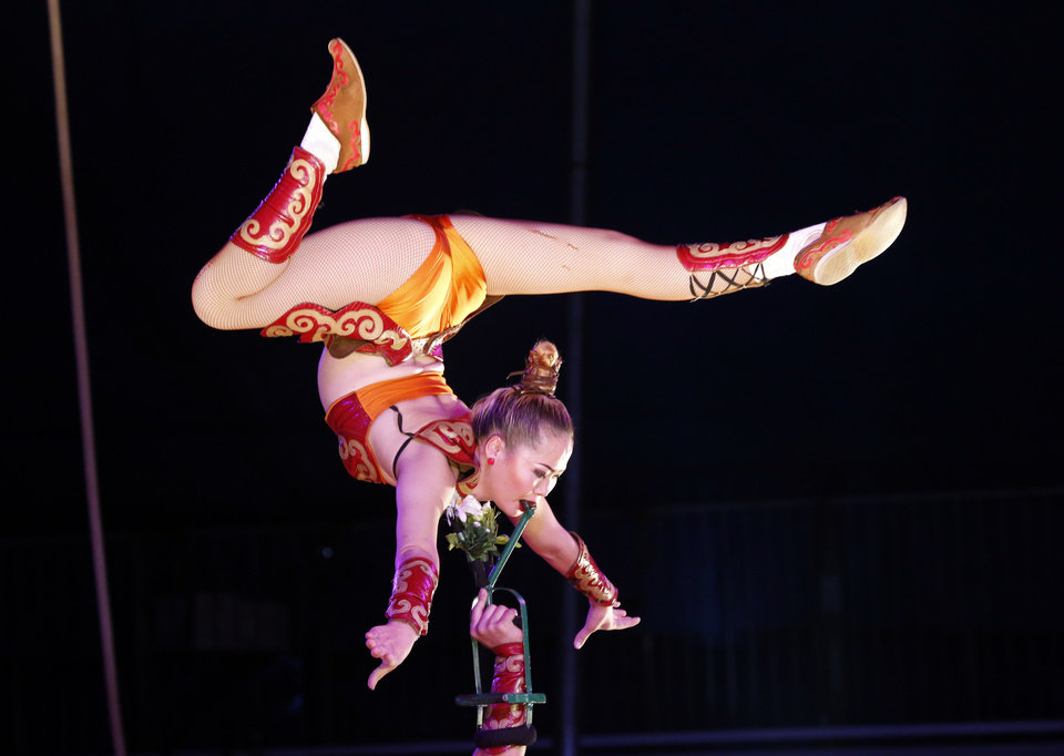 Photo -  Mongolian aerialists perform Tuesday in Pauls Valley. [PHOTO BY STEVE SISNEY, THE OKLAHOMAN]