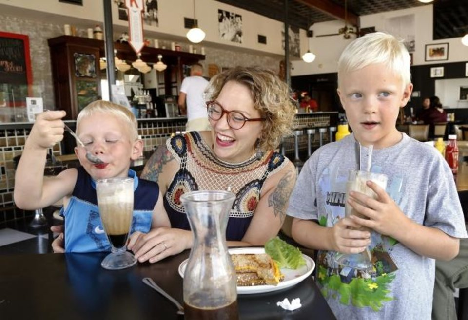 Photo -  Beth Lyon with her sons, Arlo, left, and Wyatt, enjoy frozen treats on a hot summer afternoon at Kaiser's Grateful Bean in Midtown. [JIM BECKEL/THE OKLAHOMAN]