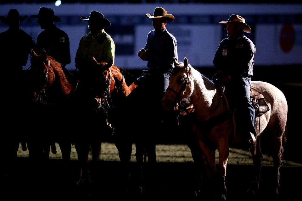 Photo - Contestants line up before the Timed Event Championship inside the Lazy E Arena in Guthrie, Okla., Friday, March 13, 2020. [Bryan Terry/The Oklahoman]