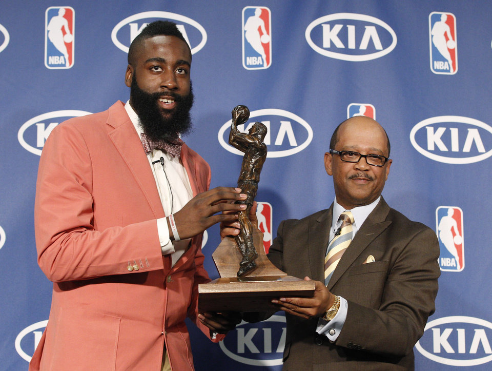 Oklahoma City Thunder�s James Harden, left, receives the NBA's Sixth Man of the Year award from Kia's Percy Vaughn, right, during a basketball news conference in Oklahoma City, Thursday, May 10, 2012. Harden led all bench players in scoring this season by averaging 16.8 points on a career-best 49 percent. (AP Photo/Sue Ogrocki)
