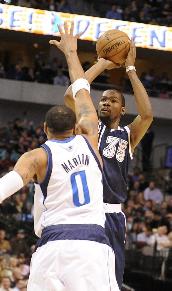 Oklahoma City Thunder forward Kevin Durant (35) shoots over Dallas Mavericks forward Shawn Marion during an NBA basketball game, Friday, Jan. 18, 2013, in Dallas. (AP Photo/Matt Strasen)