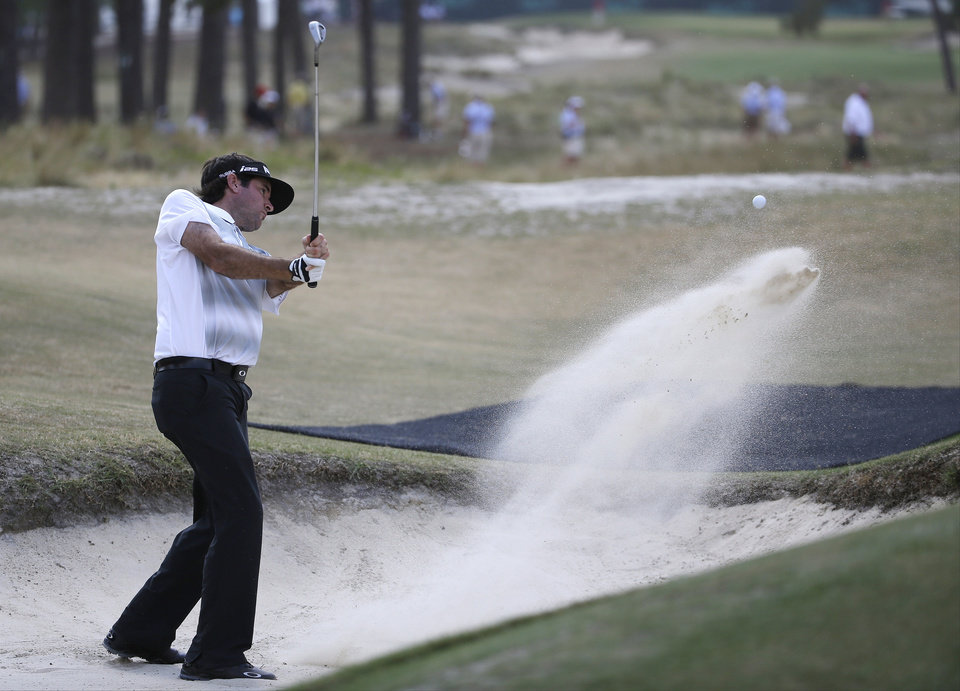 Photo - Bubba Watson hits out of the bunker on the 14th hole during a practice round for the U.S. Open golf tournament in Pinehurst, N.C., Wednesday, June 11, 2014. The tournament starts Thursday. (AP Photo/David Goldman)