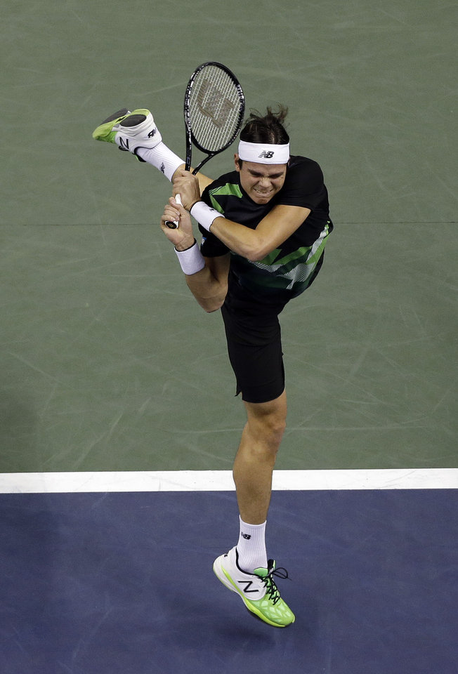 Photo - Milos Raonic, of Canada, returns to Denis Istomin, of Uzbekistan, during the SAP Open tennis tournament in San Jose, Calif., Friday Feb. 15, 2013. (AP Photo/Marcio Jose Sanchez)