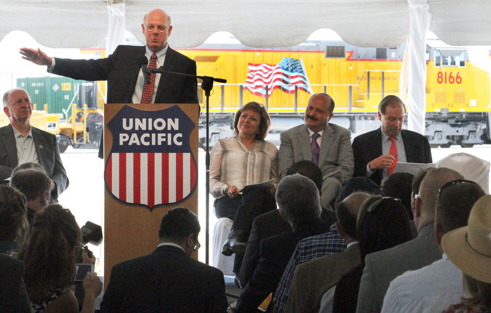 Photo - Rep. Steve Pearce, R-N.M., speaks at the opening of the Union Pacific intermodal terminal in Santa Teresa, N.M., Wednesday, May 28, 2014. Seated at right are New Mexico Gov. Susana Martinez; Chihuahua, Mexico, Gov. Cesar Duarte; and Sen. Tom Udall, D-N.M. At left is Union Pacific CEO Jack Koraleski. The facility spans 2,200 acres and also includes fueling facilities and crew-change buildings. (AP Photo/El Paso Times, Rudy Gutierrez)