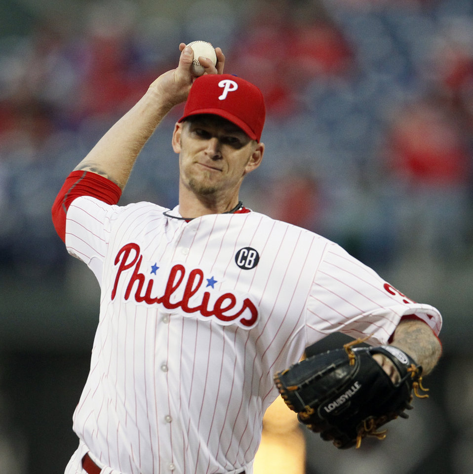 Photo - Philadelphia Phillies' A. J. Burnett throws during the first inning of a baseball game against the Miami Marlins, Friday, April 11, 2014, in Philadelphia. (AP Photo/Tom Mihalek)