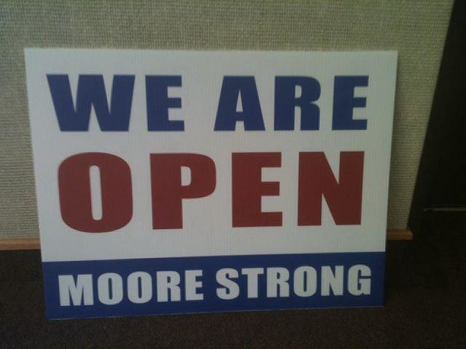 Photo - Expect to see businesses in Moore hanging these signs, provided by the City, as the economic recovery begins.   - PROVIDED