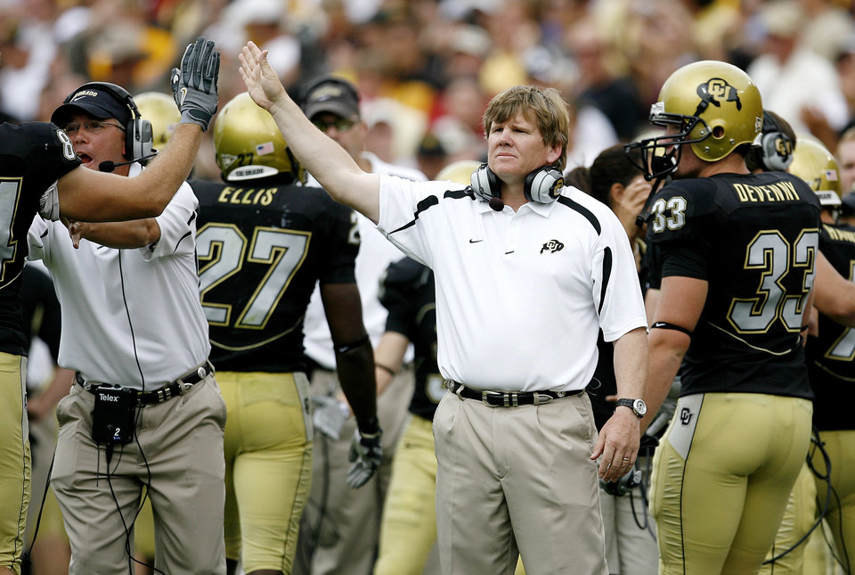 Photo - Colorado coach Dan Hawkins celebrates after a touchdown during the second half of the college football game between the University of Oklahoma Sooners (OU) and the University of Colorado Buffaloes (CU) at Folsom Field on Saturday, Sept. 28, 2007, in Boulder, Co.  By Bryan Terry, The Oklahoman