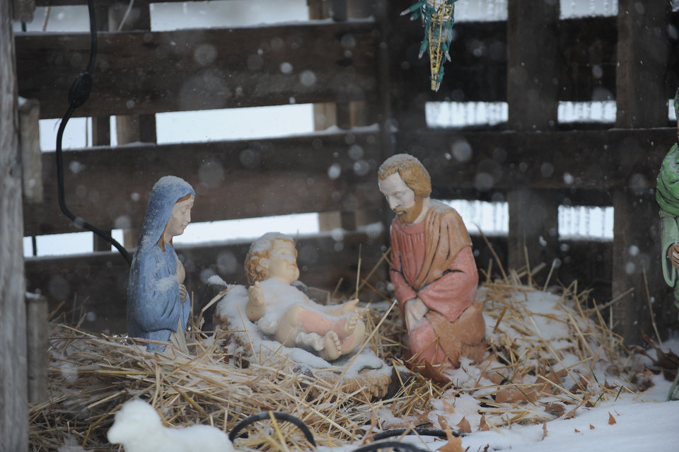 Snow falls on a nativity display at the home of Jerry and Linda Thompson on Metropolis Lake Road near Paducah, Ky., Friday, Dec. 6, 2013. A winter mix of precipitation will continue through the day. A second winter storm is forecasted for Saturday night. (AP Photo/Stephen Lance Dennee)