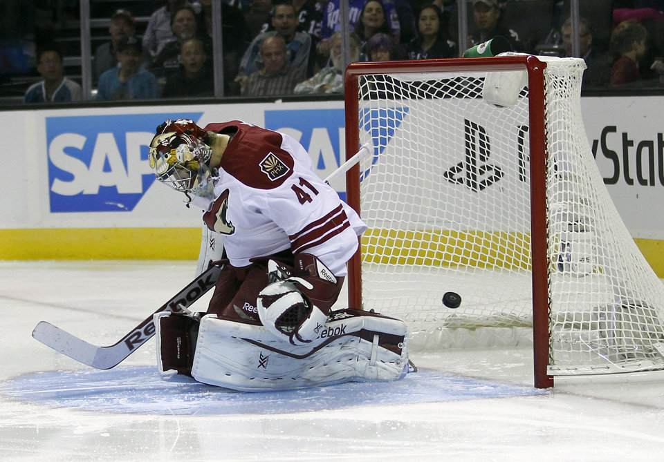 Phoenix Coyotes goalie Mike Smith (41) is beaten for a goal on a shot from San Jose Sharks center Tomas Hertl during the first period an NHL hockey game in San Jose, Calif., Saturday, Oct. 5, 2013. (AP Photo/Tony Avelar)