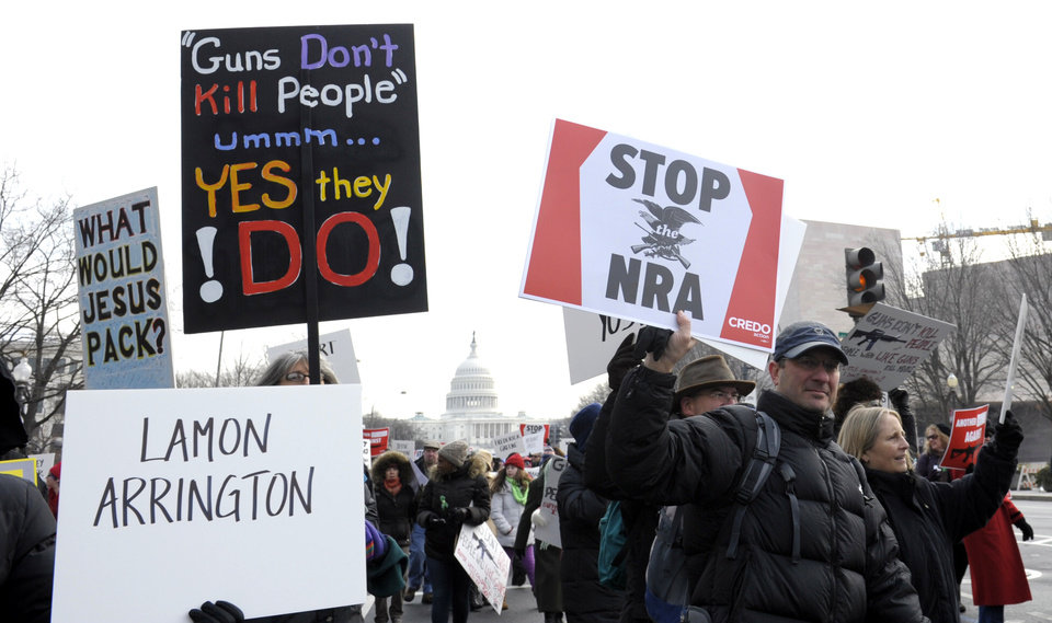 People walk from the U.S. Capitol to the Washington Monument in Washington, Saturday, Jan. 26, 2013, for a march on Washington for gun control. (AP Photo/Susan Walsh)