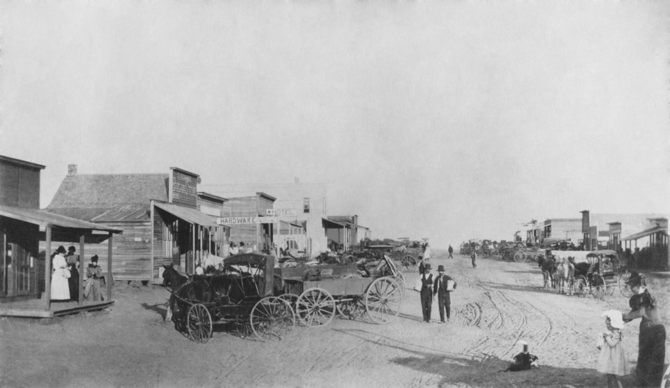 "EARLY DAYS / STREET SCENES / OKLAHOMA CITY:  ""Mid-summer 1889,  Near Santa Fe Station."""