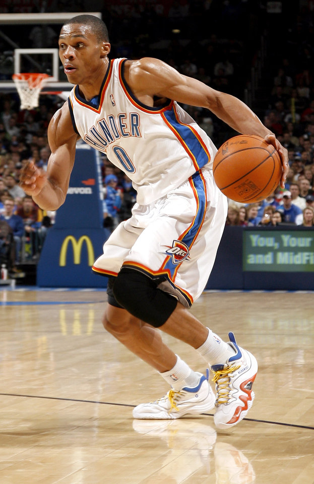 Photo - Oklahoma City's Russell Westbrook (0) drives to the basket during the NBA game between the Oklahoma City Thunder and the Cleveland Cavaliers, Sunday, Dec. 13, 2009, at the Ford Center in Oklahoma City. Photo by Sarah Phipps, The Oklahoman