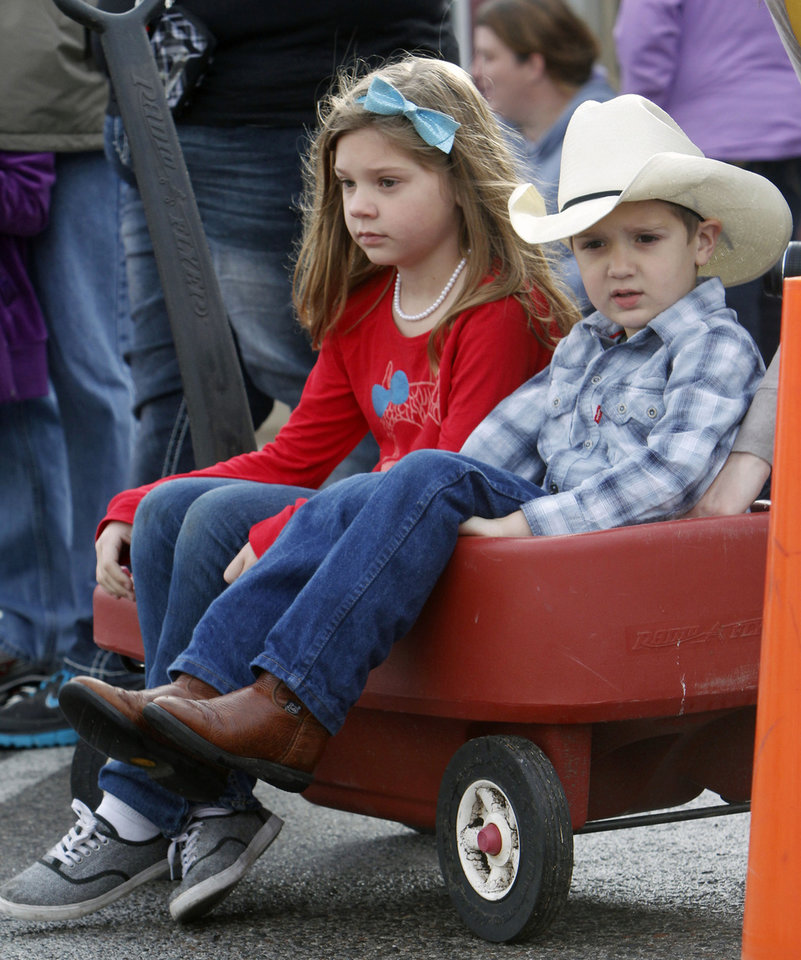 Lola Meek, 7, and her brother Grady, 5, watch the Stockyards City Christmas parade in Oklahoma City, OK, Saturday, December 1, 2012,  By Paul Hellstern, The Oklahoman