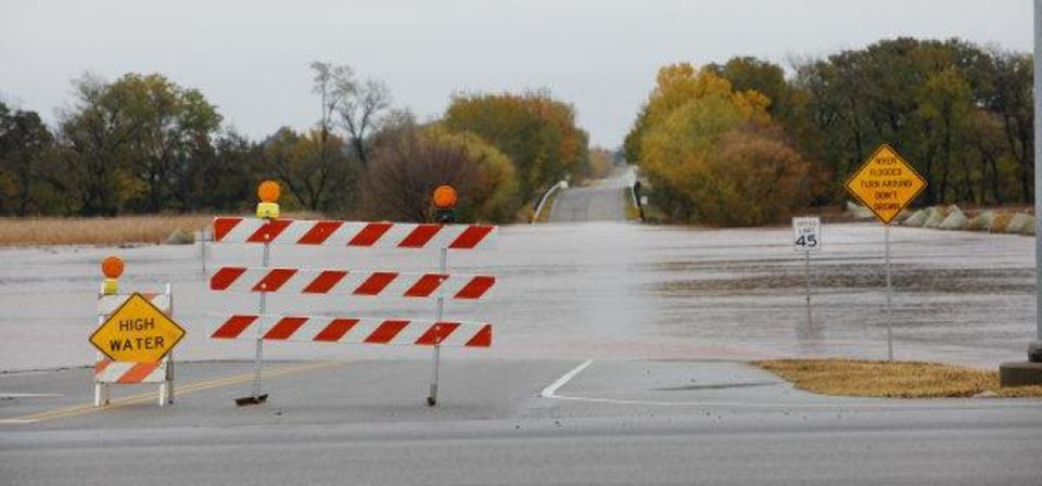 Photo - Water running across NW  220 Street east of Portland after heavy rains in Oklahoma City Tuesday, Nov. 8, 2011. Photo by Paul B. Southerland, The Oklahoman ORG XMIT: KOD