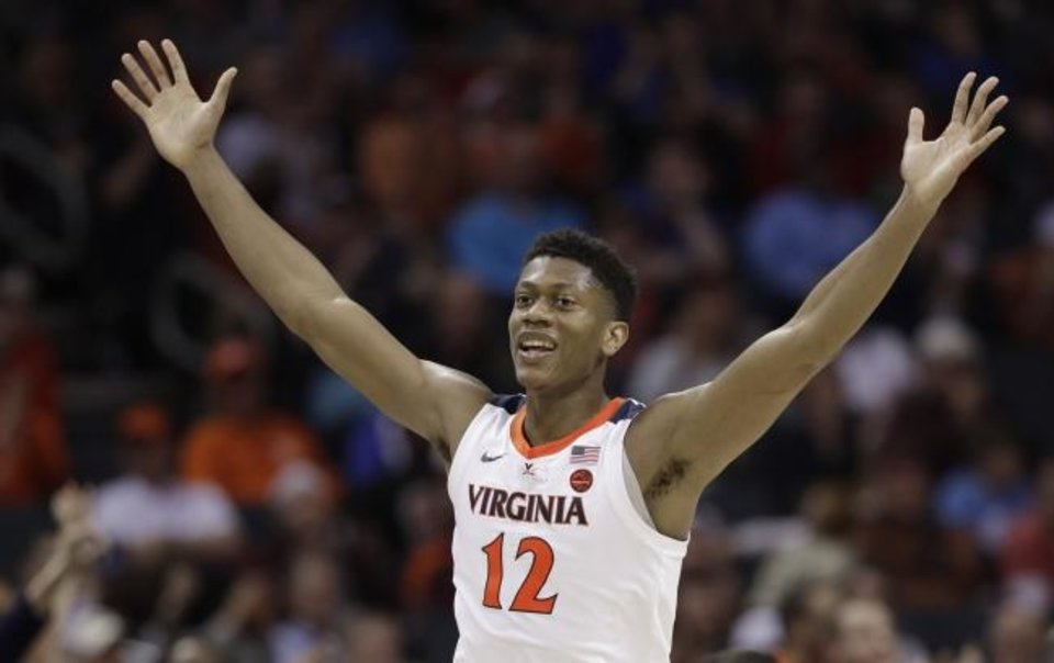 Photo -  Virginia's De'Andre Hunter (12) reacts after making a basket against North Carolina State during the second half of an NCAA college basketball game in the Atlantic Coast Conference tournament in Charlotte, N.C., Thursday, March 14, 2019. (AP Photo/Chuck Burton)