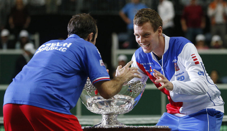 Photo -   Czech Republic's Radek Stepanek, left, and Tomas Berdych, right, celebrate with the trophy after defeating Spain in their Davis Cup finals tennis match in Prague, Czech Republic, Sunday, Nov. 18, 2012. Czech Republic defeated Spain 3-2 and gained the Davis Cup trophy. (AP Photo/Petr David Josek)