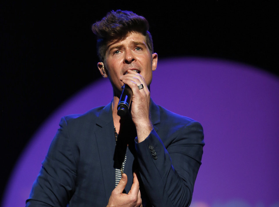 "FILE - This Sept. 15, 2012 file photo released by  Point Foundation shows Robin Thicke performing at ""Voices On Point"" Concert & Gala  in Los Angeles. Thisck's �Blurred Lines,"" featuring T.I. & Pharrell was the top selling song on iTunes for the week ending June 17, 2013. (AP Photo/Point Foundation, Colin Young-Wolff)"