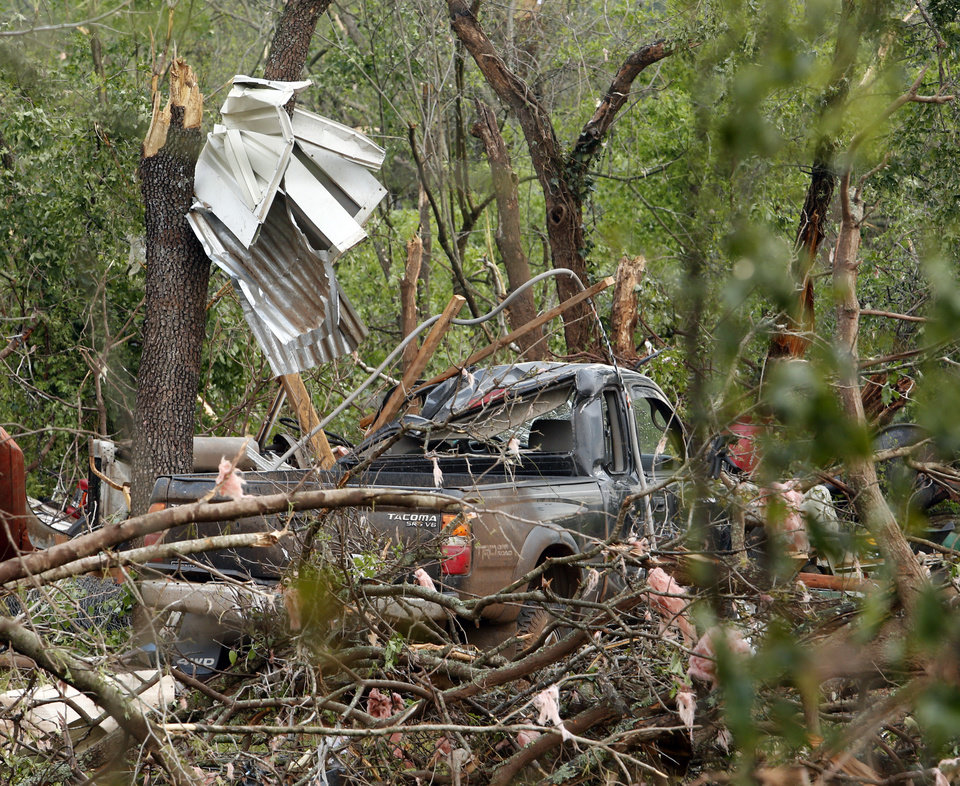 Photo - Broken trees and parts of buildings show damage from a tornado that struck near 156th street and Franklin Road on Sunday, May 19, 2013  in Norman, Okla. Photo by Steve Sisney, The Oklahoman