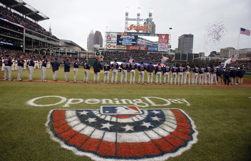 Photo - Balloons fly during the national anthem before a baseball game between the Minnesota Twins and the Cleveland Indians, Friday, April 4, 2014, in Cleveland. (AP Photo/Tony Dejak)