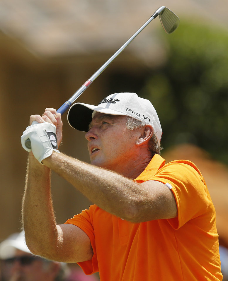 Photo - Lance Ten Broeck hits from the tee box on No. 8 during the third round of the U.S. Senior Open golf tournament at Oak Tree National in Edmond, Okla., Saturday, July 12, 2014. Photo by Nate Billings, The Oklahoman