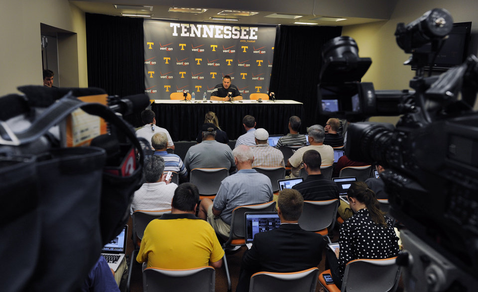 Photo - University of Tennessee NCAA college football coach Butch Jones talks about the upcoming season during a press conference Thursday, July 31, 2014, in Knoxville, Tenn. The Vols open at home Aug. 31 against Utah State. (AP Photo, Michael Patrick/Knoxville News Sentinel)