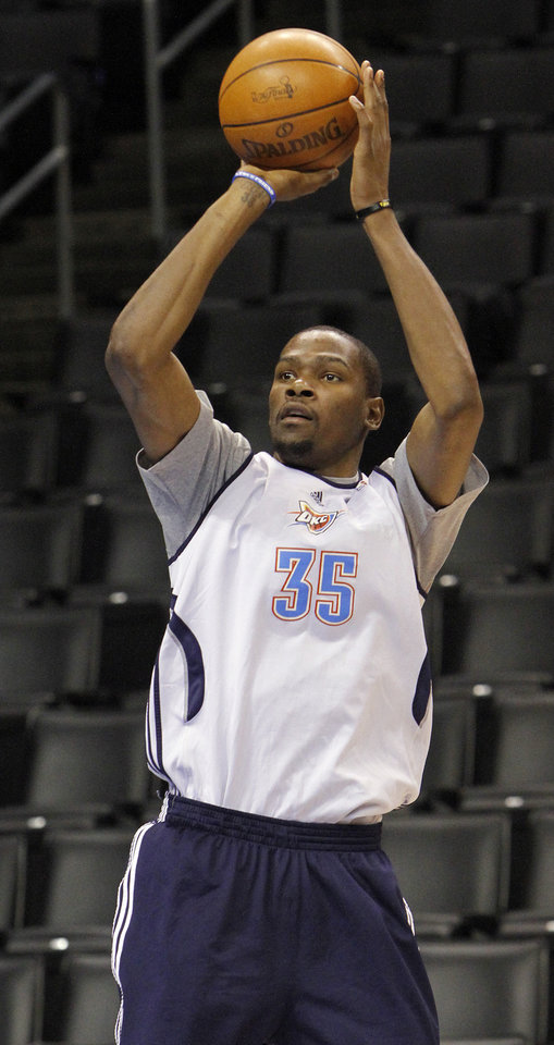 Photo - Oklahoma City's Kevin Durant takes a shot during the NBA Finals practice day at the Chesapeake Energy Arena on Monday, June 11, 2012, in Oklahoma City, Okla. Photo by Chris Landsberger, The Oklahoman