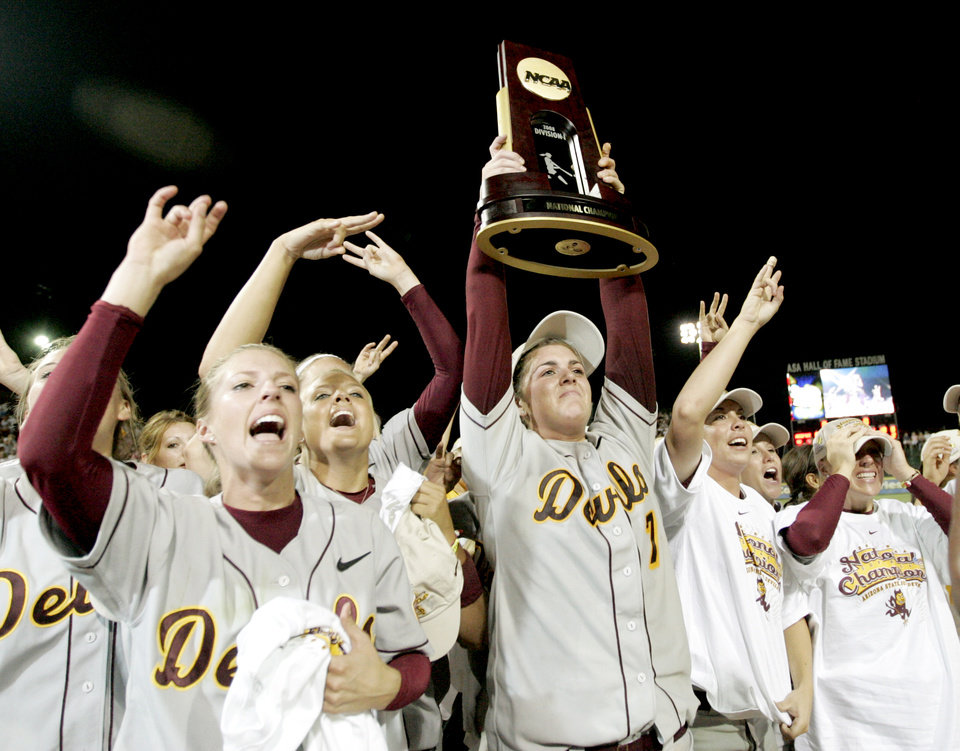 Photo - COLLEGE SOFTBALL, CELEBRATE, CELEBRATION, TROPHY: Arizona State's Katie Burkhart, center, celebrates after winning the championship game of the Women's College World Series between Texas A&M University and Arizona State University at ASA Hall of Fame Stadium in Oklahoma City, Tuesday, June 3, 2008. BY BRYAN TERRY, THE OKLAHOMAN ORG XMIT: KOD