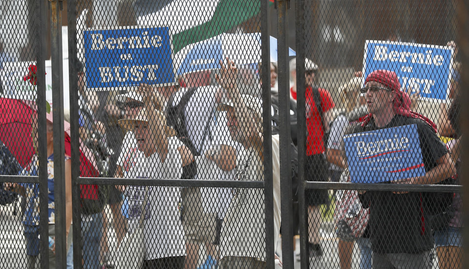Photo - Supporters of Sen. Bernie Sanders, I-Vt., yell at delegates through the fence at Franklin Delano Roosevelt Park in Philadelphia, Tuesday, July 26, 2016, during the second day of the Democratic National Convention. (AP Photo/Alex Brandon)