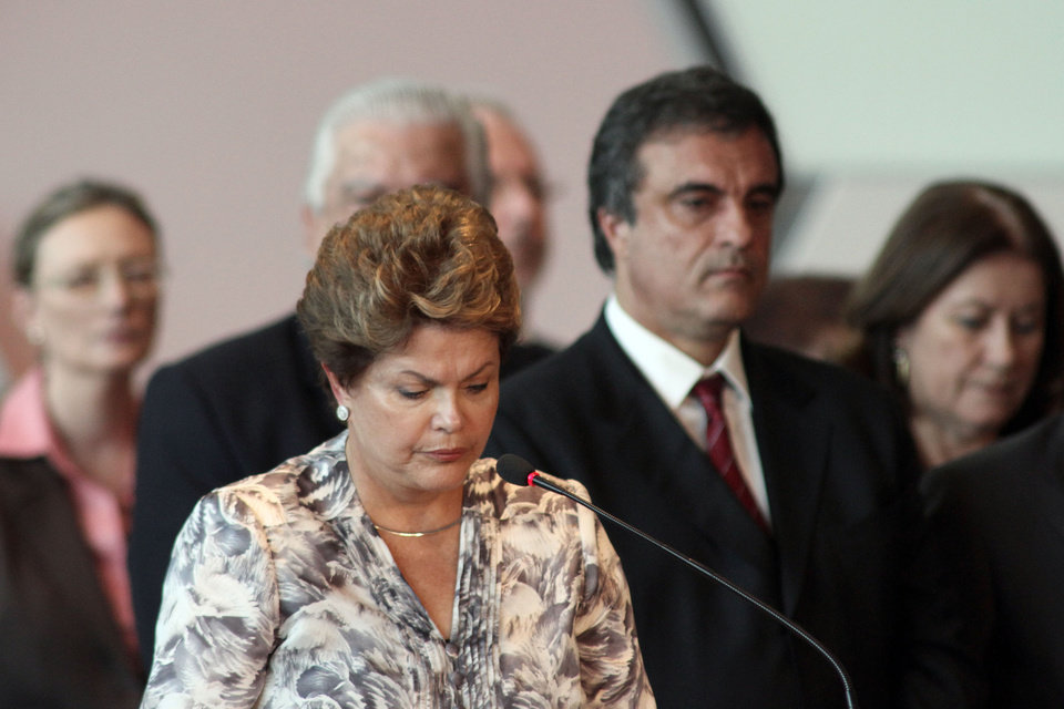 Brazil's President Dilma Rousseff, front, stands a minute of silence for the victims of a deadly fire at a nightclub during a meeting with mayors who recently took office in Brasilia, Brazil, Monday, Jan. 28, 2013. A blaze raced through a crowded nightclub in southern Brazil early Sunday, killing more than 230 people as the air filled with deadly smoke and panicked party-goers stampeded toward the exits, police and witnesses said. (AP Photo/Eraldo Peres) ORG XMIT: BSB111