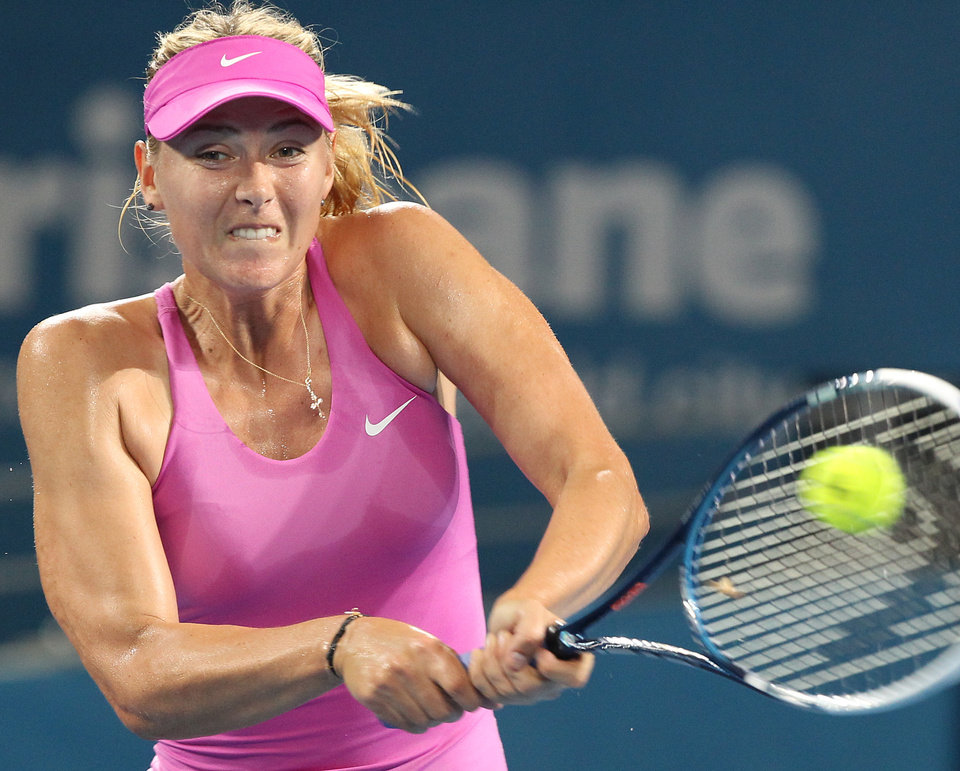 Photo - Maria Sharapova of Russia plays a shot in her semifinal match against Serena Williams of the U.S.  during the Brisbane International tennis tournament in Brisbane, Australia, Friday, Jan. 3, 2014. (AP Photo/Tertius Pickard)