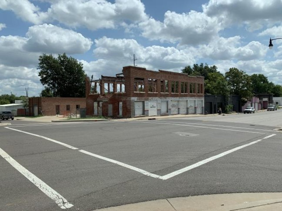 Photo -  The walls of the second floor of the former Robinson Trading Post were taken down after they were damaged by storms in August. [PROVIDED]