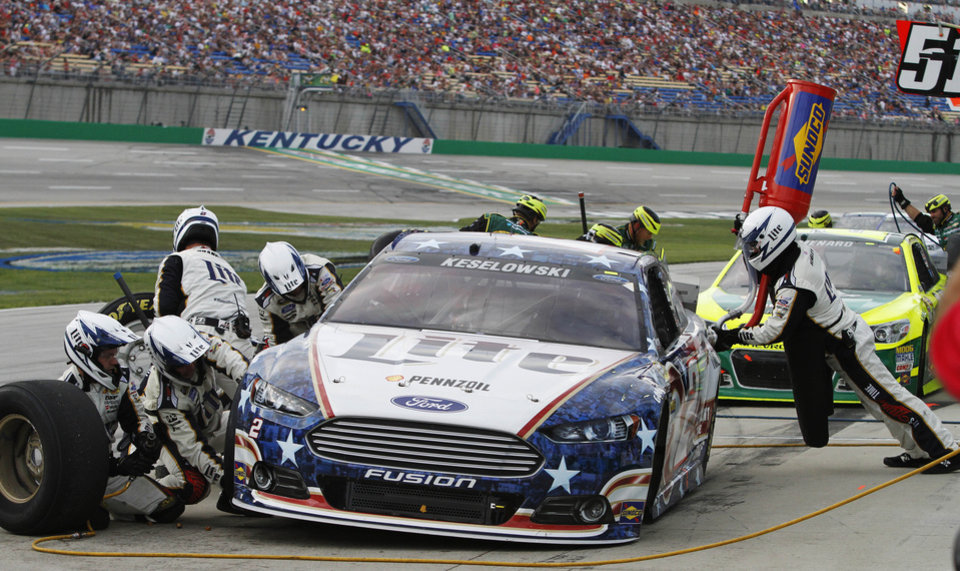 Brad Keselowski pits during the first caution of the NASCAR Sprint Cup series auto race Saturday, June  28, 2014, at Kentucky Speedway in Sparta, Ky. (AP Photo/James Crisp)