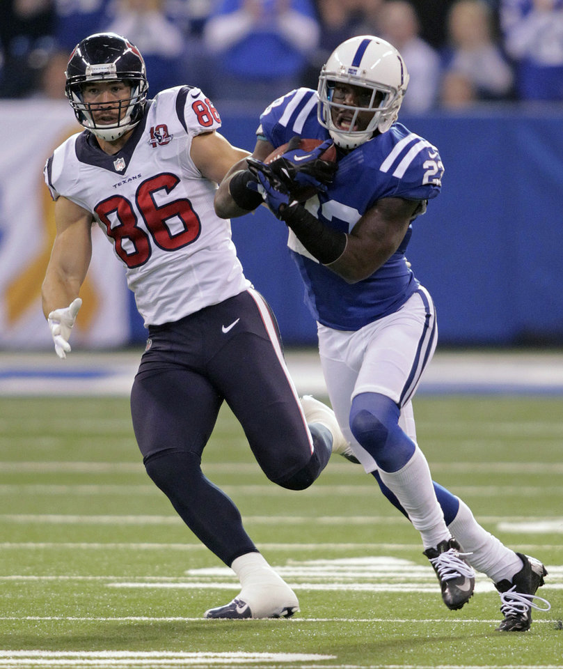 Photo - Indianapolis Colts' Vontae Davis (23) is chased by Houston Texans' James Casey (86) following an interception during the first half of an NFL football game on Sunday, Dec. 30, 2012, in Indianapolis. (AP Photo/AJ Mast)