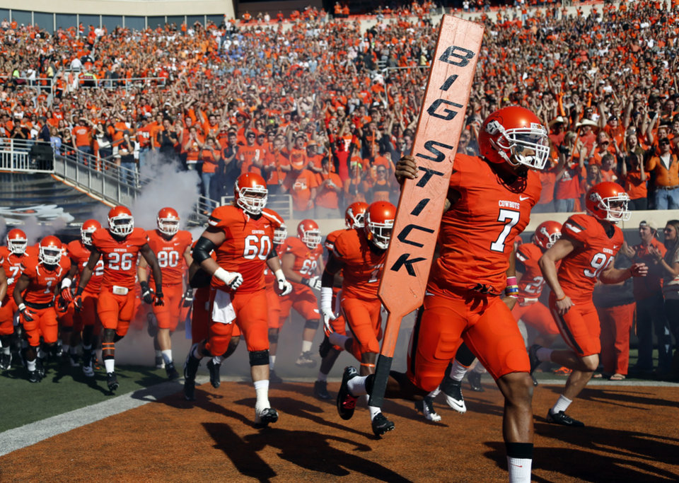 Photo - Oklahoma State takes the field before a college football game between Oklahoma State University (OSU) and Iowa State University (ISU) at Boone Pickens Stadium in Stillwater, Okla., Saturday, Oct. 20, 2012. Photo by Sarah Phipps, The Oklahoman