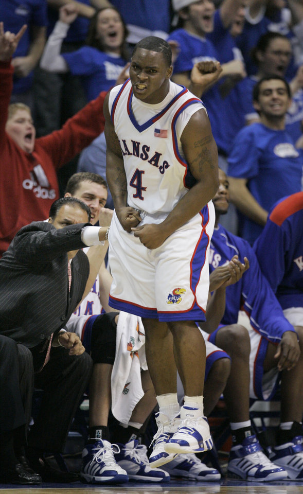 Photo - Kansas guard Sherron Collins (4) celebrates a three-point basket during the second half of their college basketball game against Missouri in Lawrence, Kan., Monday, Jan. 15, 2007. Collins scored 23 points to lead Kansas to an 80-77 win over Missouri. (AP Photo/Orlin Wagner) ORG XMIT: KSOW105