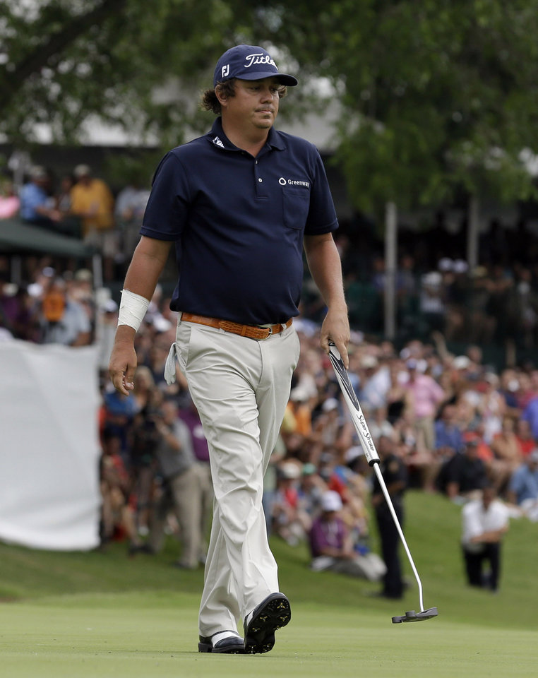 Photo - Jason Dufner reacts after missing a putt on the third playoff on the 18th hole during the final round of the PGA Colonial golf tournament in Fort Worth, Texas, Sunday, May 25, 2014. Adam Scott went on to win. (AP Photo/LM Otero)