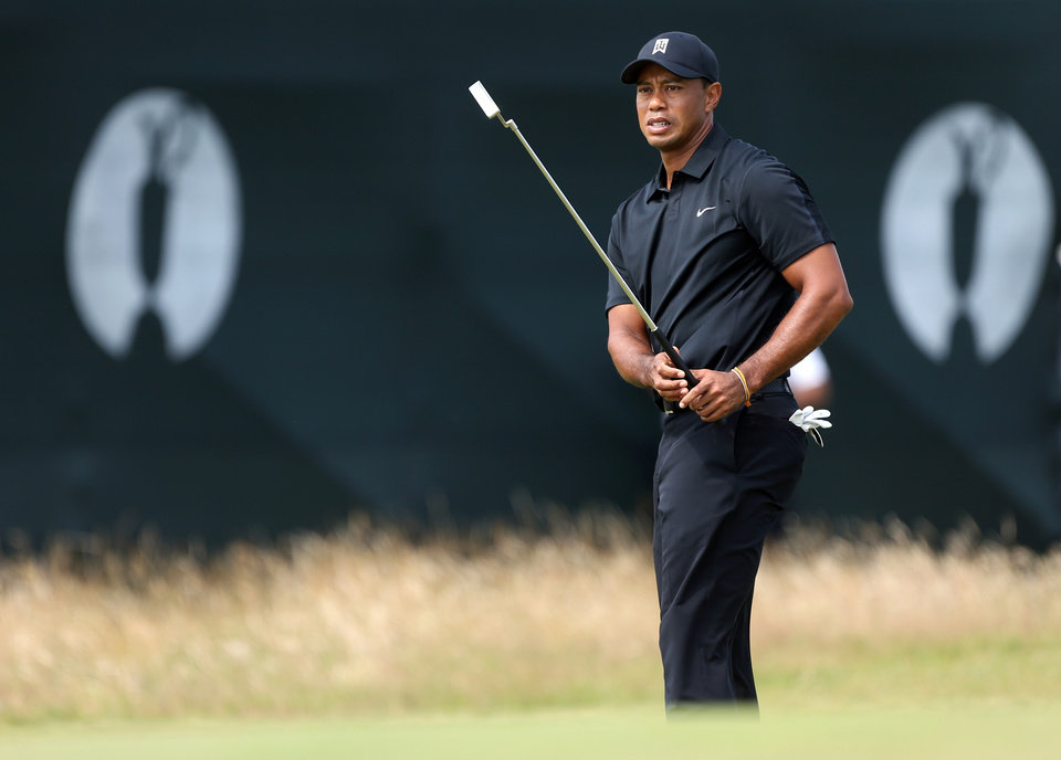 Photo - Tiger Woods of the US prepares to putt on the 7th green during the second day of the British Open Golf championship at the Royal Liverpool golf club, Hoylake, England, Friday July 18, 2014. (AP Photo/Peter Morrison)