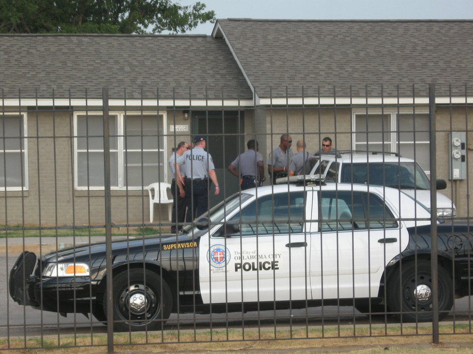 Law officers swept through the Sooner Haven apartments at NE 36 and Lottie Thursday evening, serving warrants and talking to residents. <strong></strong>