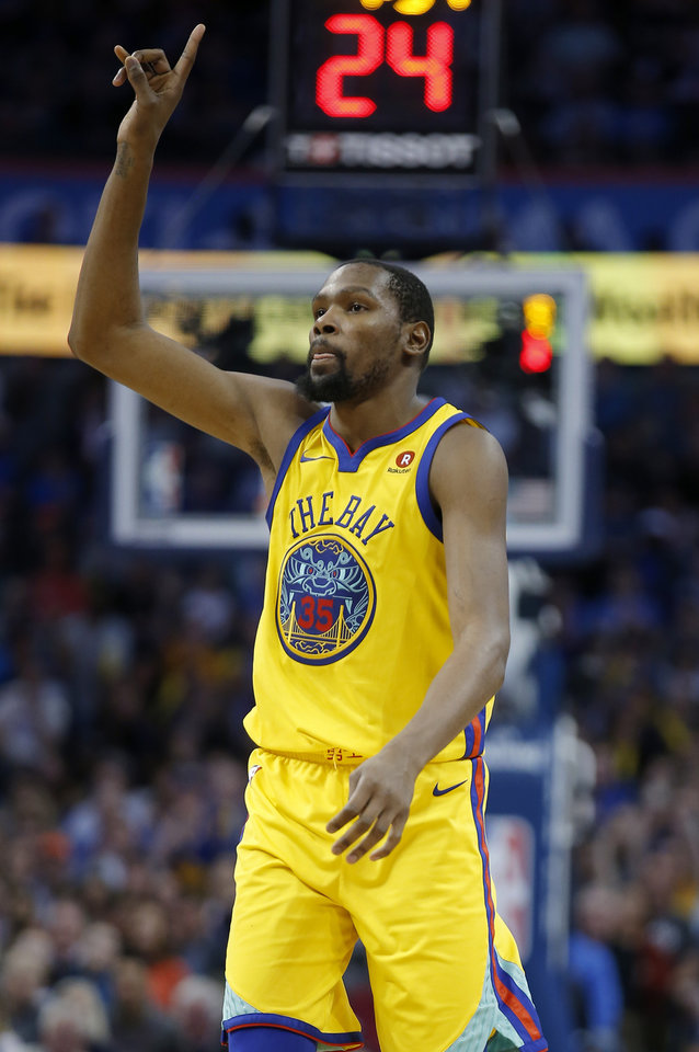 Photo - Golden State's Kevin Durant (35) celebrates a basket during the NBA basketball game between the Oklahoma City Thunder and the Golden State Warriors at the Chesapeake Energy Arena,  Tuesday, April 3, 2018. Photo by Sarah Phipps, The Oklahoman
