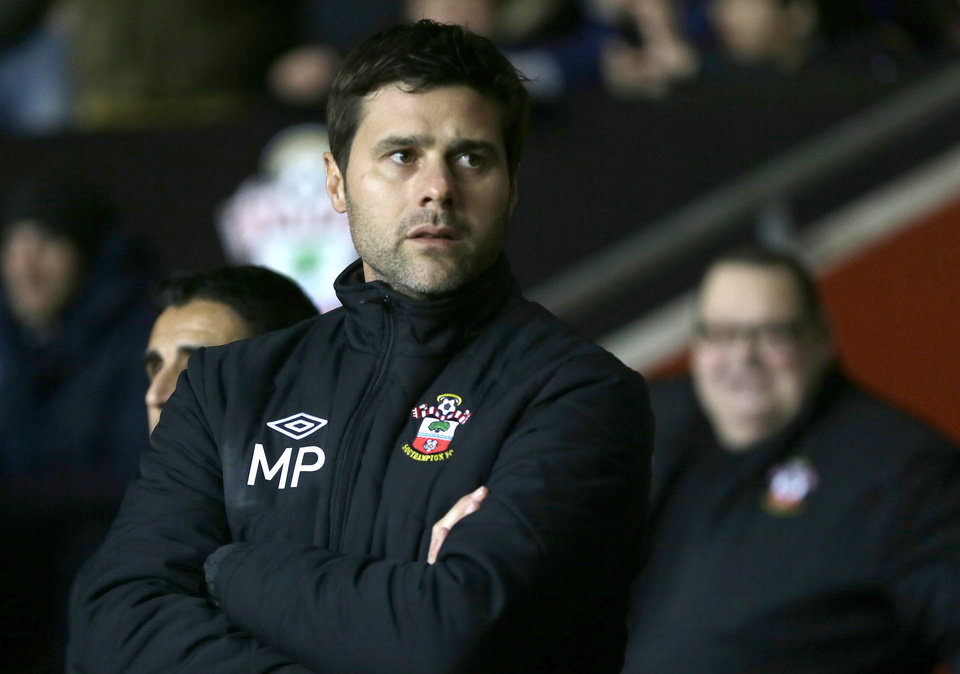 Southampton's new manager Mauricio Pochettino looks out from the technical area prior his teams game against Everton in their English Premier league soccer match at Southampton's St Mary's stadium in Southampton, England, Monday, Jan. 21, 2013.(AP Photo/Alastair Grant)