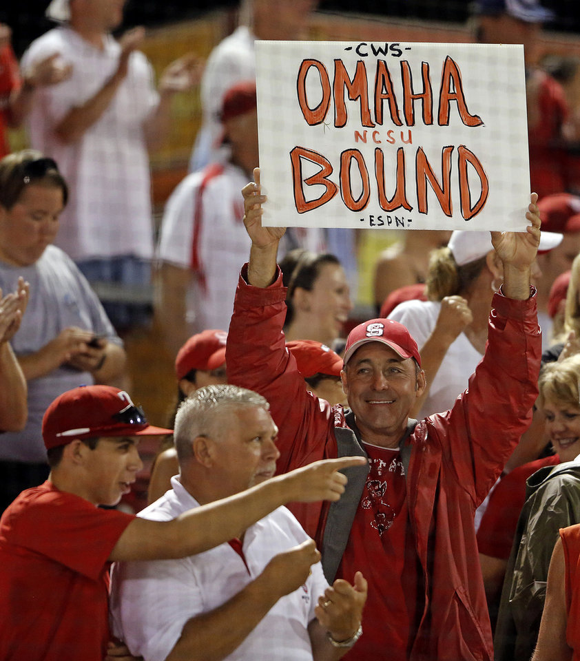 Photo - An unidentified North Carolina State fan holds up a sign following States' 5-4 win over Rice in 17 innings during an NCAA college baseball tournament super regional game, Sunday, June 9, 2013, in Raleigh, N.C. (AP Photo/Karl B DeBlaker)