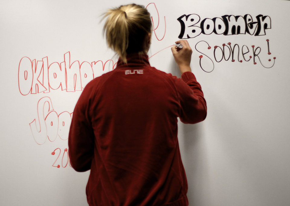 OU's Lauren Willis writes on a dry erase board in the locker room before practice in Kansas City, Mo., on Saturday, March 27, 2010. The University of Oklahoma will play Notre Dame in the Sweet 16 round of the NCAA women's  basketball tournament on Sunday.