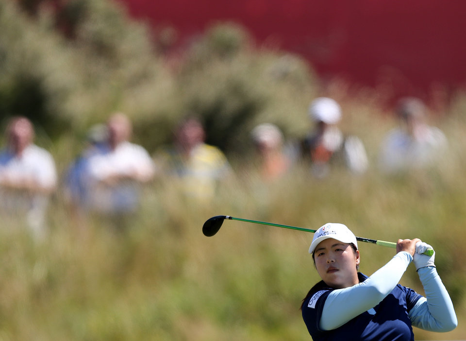 Photo - China's Shanshan Feng plays a shot from the 10th tee during the second day of the Women's British Open golf championship on the Royal Birkdale Golf Club, Southport, England, Friday July 11, 2014. (AP Photo/Scott Heppell)