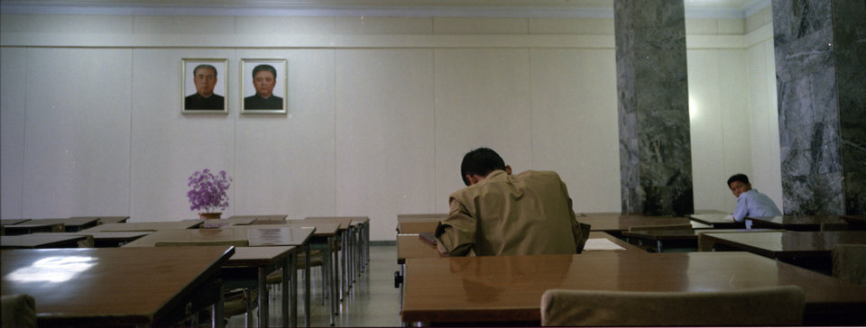 In this Sept. 10, 2012 photo, North Korean men study in desks beneath portraits of the country\'s late leaders, Kim Il Sung, left, and Kim Jong Il, at the Grand People\'s Study House in Pyongyang, North Korea. (AP Photo/David Guttenfelder)