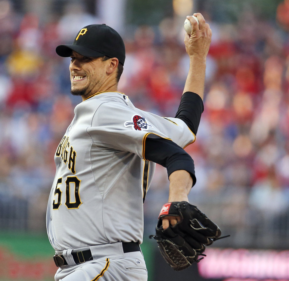 Photo - Pittsburgh Pirates starting pitcher Charlie Morton throws during the first inning of a baseball game against the Washington Nationals at Nationals Park, Friday, Aug. 15, 2014, in Washington. (AP Photo/Alex Brandon)