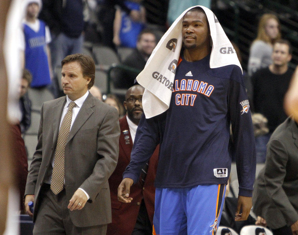 Photo - Oklahoma City's Kevin Durant (35) and head coach Scott Brooks walk of the court following the pre season NBA game between the Dallas Mavericks and the Oklahoma City Thunder at the American Airlines Center in Dallas, Sunday, Dec. 18, 2011. Photo by Sarah Phipps, The Oklahoman